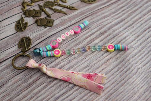 Porte-clés ou bijou de sac personnalisé bleu rose